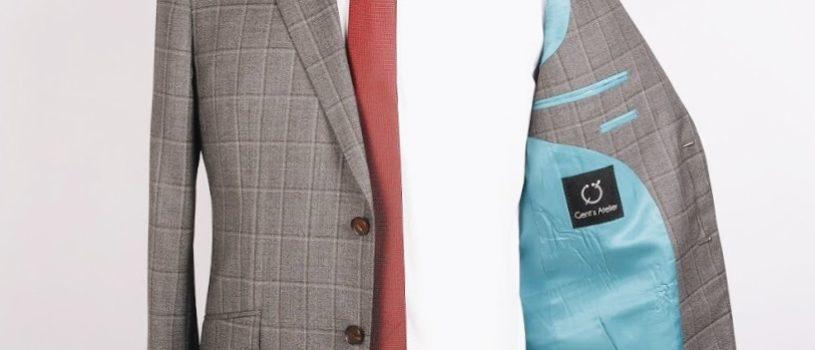 Пиджак из итальянской шерсти с контрастной петлей на лацкане и наклонными карманами.